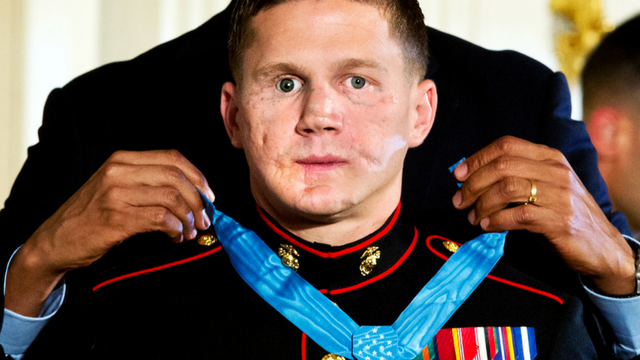 """Retired Marine Cpl. William """"Kyle"""" Carpenter receives the Medal of Honor for conspicuous gallantry, in a 2014 ceremony (AP Photo/Jacquelyn Martin)"""
