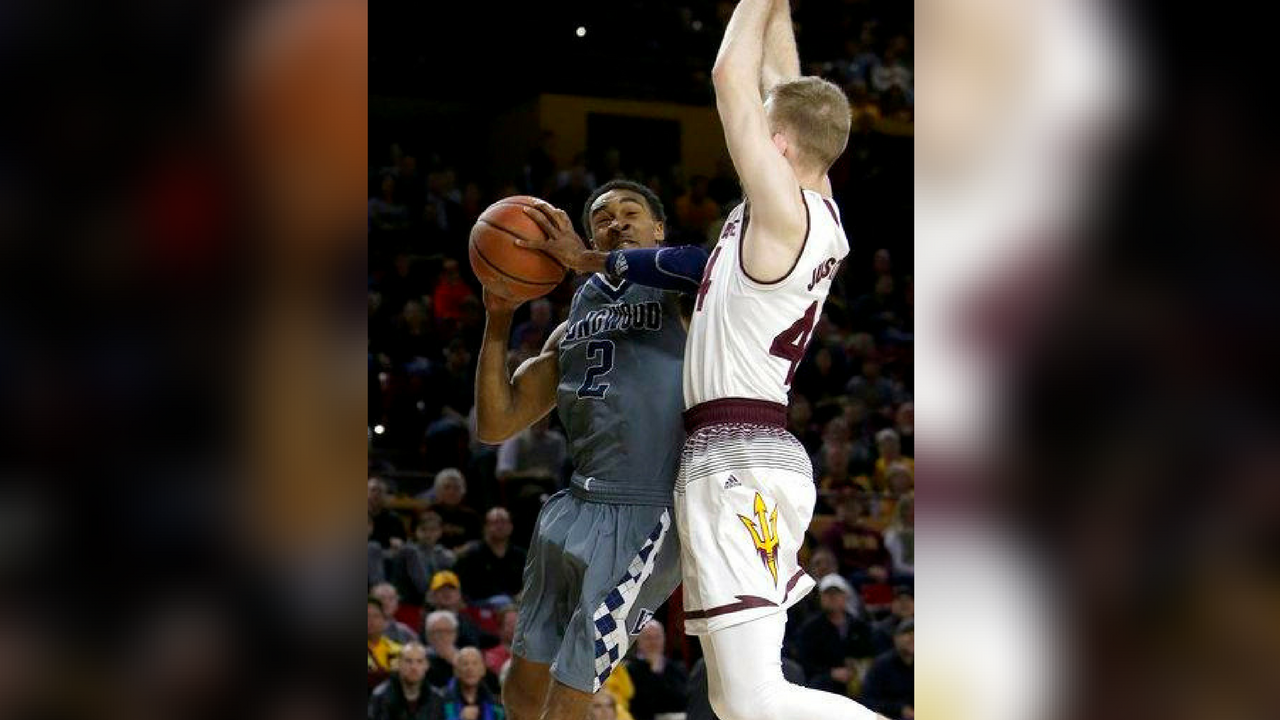 Longwood guard B.K. Ashe (2) drives on Arizona State guard Kodi Justice in the first half during an NCAA college basketball game, Tuesday, Dec 19, 2017, in Tempe, Ariz. (Source: AP Photo/Rick Scuteri)