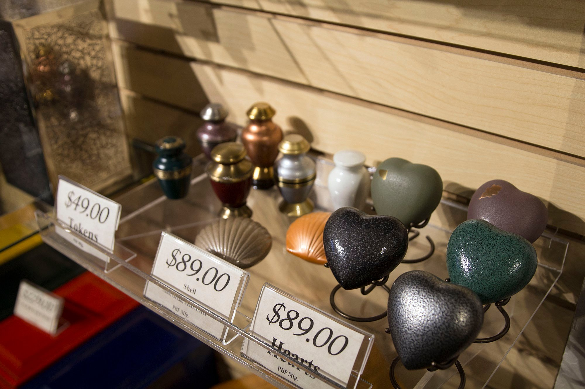 At Wyman Cremation & Burial Chapel in Mesa, people can purchase small urns, also known as tokens, if family members wish to divide their loved one's ashes. (Source: Maddy Ryan/Cronkite News)