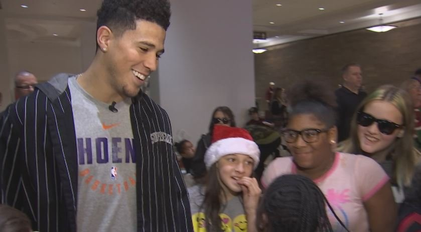 Devin Booker takes 25 kids on a holiday shopping spree at Dick's Sporting Goods in Scottsdale. (Source: 3TV/CBS 5)