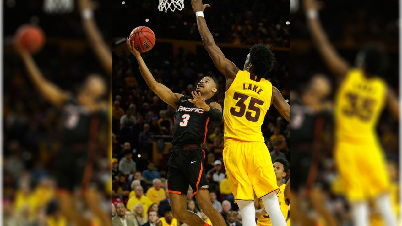 Pacific guard Miles Reynolds, left, drives on Arizona State forward De'Quon Lake (35) in the first half during an NCAA college basketball game, Friday, Dec 22, 2017, in Tempe, Ariz. (Source: AP Photo/Rick Scuteri)