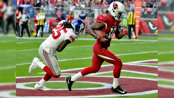 Arizona Cardinals wide receiver John Brown (12) scores as New York Giants defensive back Brandon Dixon (25) defends during the second half of an NFL football game, Sunday, Dec. 24, 2017, in Glendale, Ariz. (Source: AP Photo/Rick Scuteri)