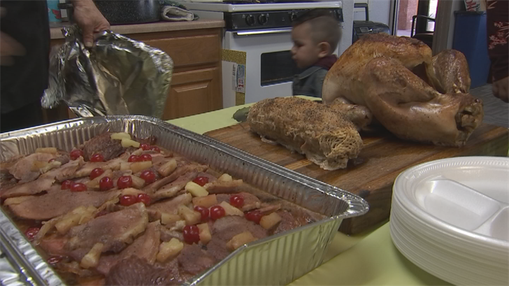 The neighbors who were strangers just hours earlier are now friends thanks to food and the spirit of the season. (Source: 3TV/CBS 5)