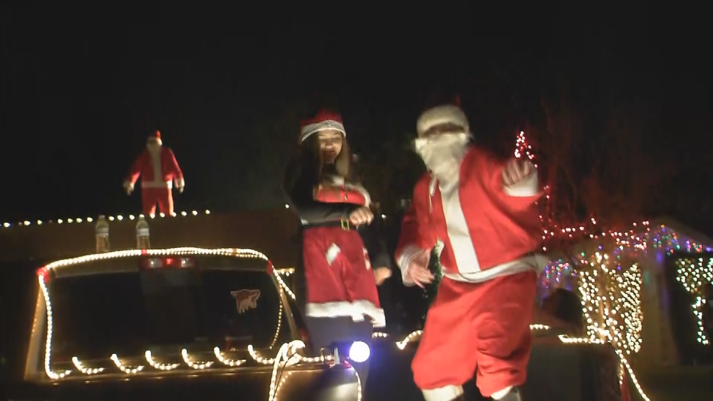 The Wagner family celebrates Christmas Eve by dressing up as Santa and dancing. (Source: 3TV/CBS 5)