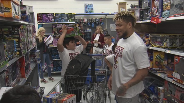 "Tyrann ""Honey Badger"" Mathieu helped kids shop as well. (Source: 3TV/CBS 5)"