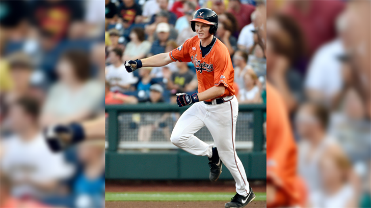 Virginia's Pavin Smith celebrates his two-run home run against Vanderbilt during the fourth inning of Game 3 of the best-of-three NCAA baseball College World Series finals, Wednesday, June 24, 2015. (Source: AP Photo/Mike Theiler)