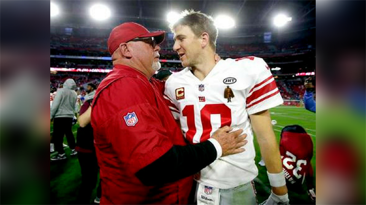New York Giants quarterback Eli Manning (10) and Arizona Cardinals head coach Bruce Arians meet after an NFL football game, Sunday, Dec. 24, 2017, in Glendale, Ariz. The Cardinals won 23-0. (Source: AP Photo/Rick Scuteri)