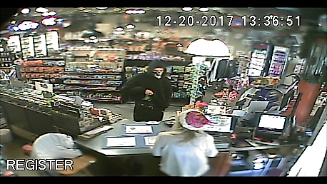 Surveillance video shows a suspect robbing a convenience store in Black Canyon City on Dec. 20, 2017. (Source: Yavapai County Sheriff's Office)