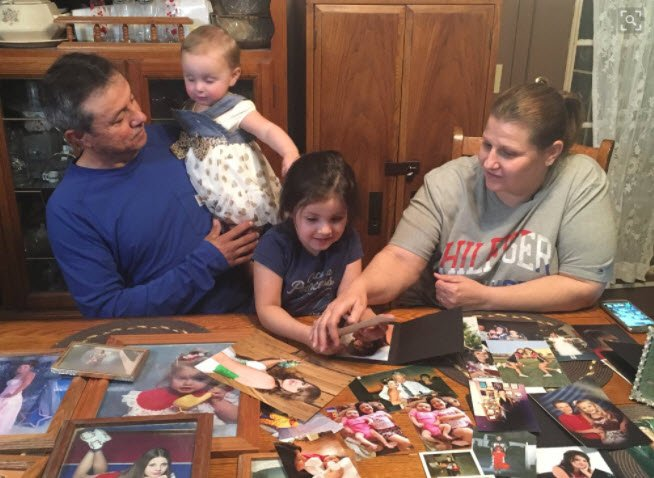 Carla Lara and her husband go through pictures of their daughter DesRay Lara with their grandchildren. DesRay was mom to these little girls. (Source: 3TV/CBS 5)