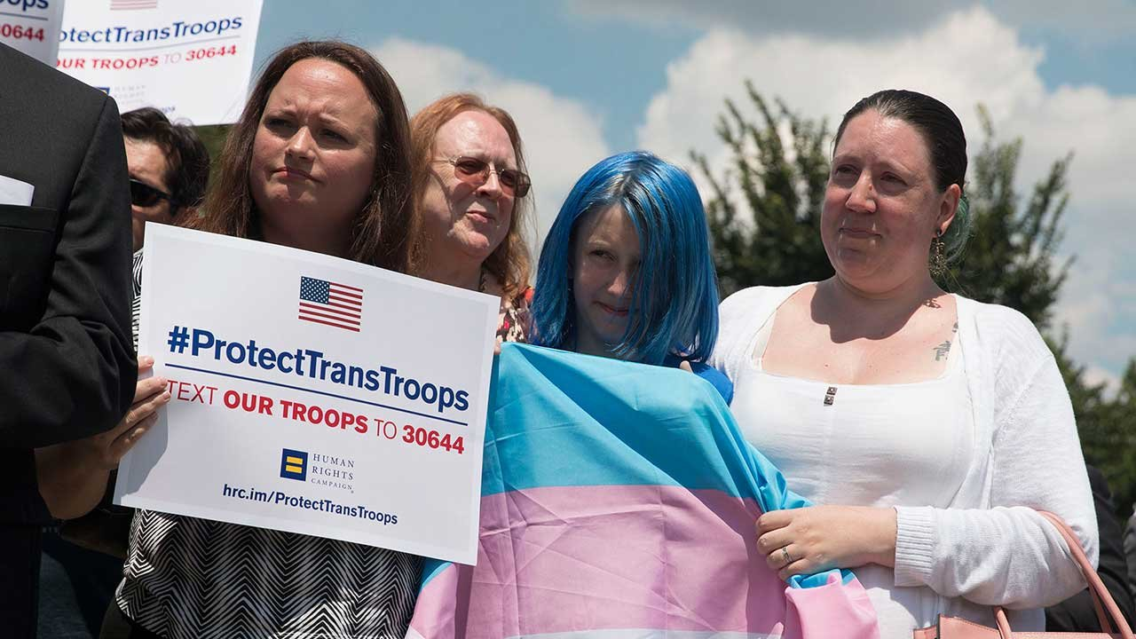 Advocates, including Jessica Girven and her 11-year-old daughter, Blue, who came out as transgender last year, rallied at the Capitol this summer against President Donald Trump's proposed ban on transgender soldiers. (Source: Megan Janetsky/Cronkite News)