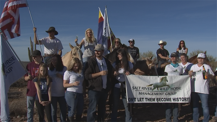 The Salt River Wild Horse Management Group celebrated with champagne. (Source: 3TV/CBS 5)