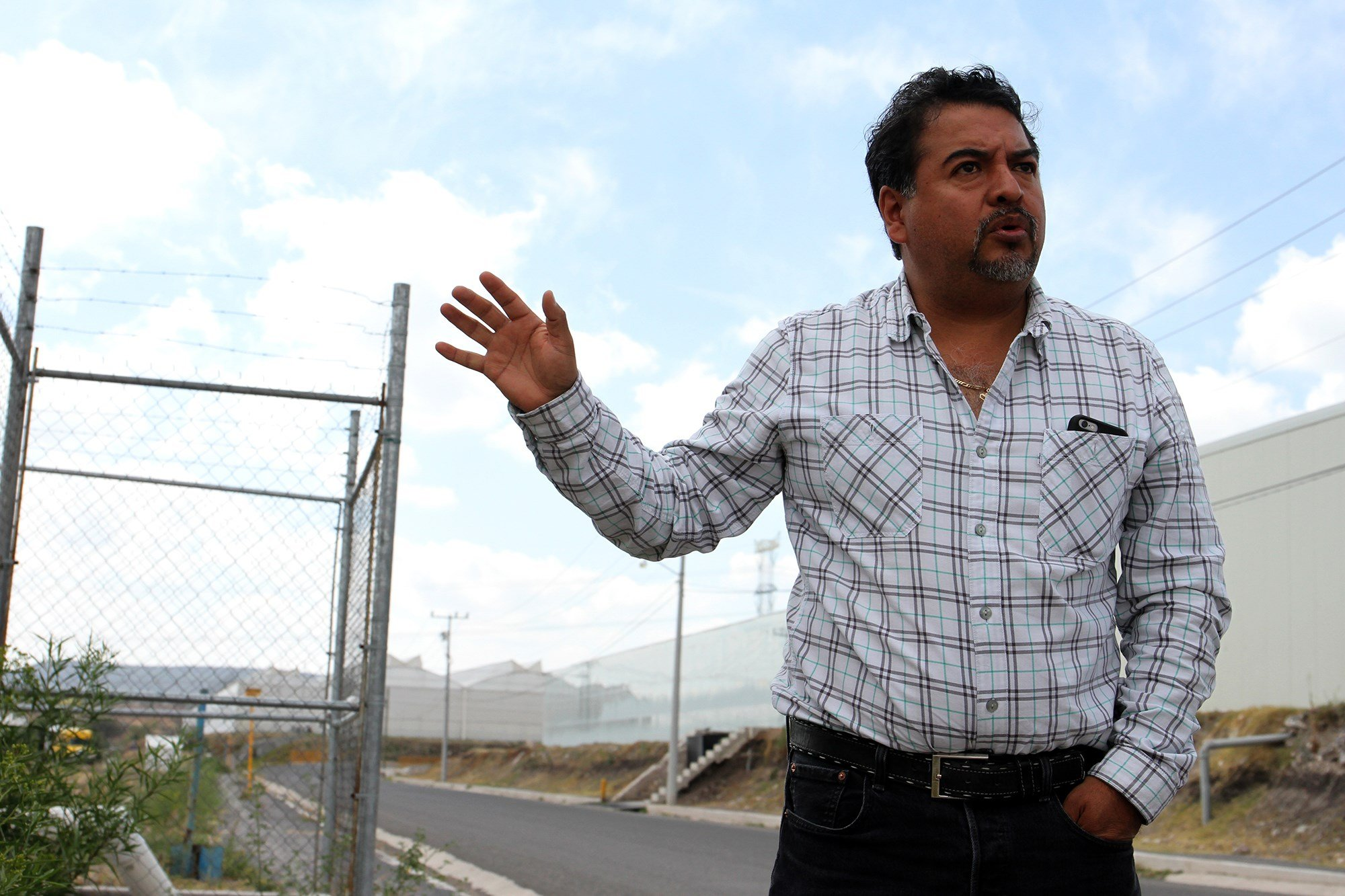 Alfonso Meneses Melo, the administrator of Agropark, stands outside the complex of greenhouses that make up Agropark in March. (Photo by Megan Janetsky/Cronkite Borderlands Initiative)