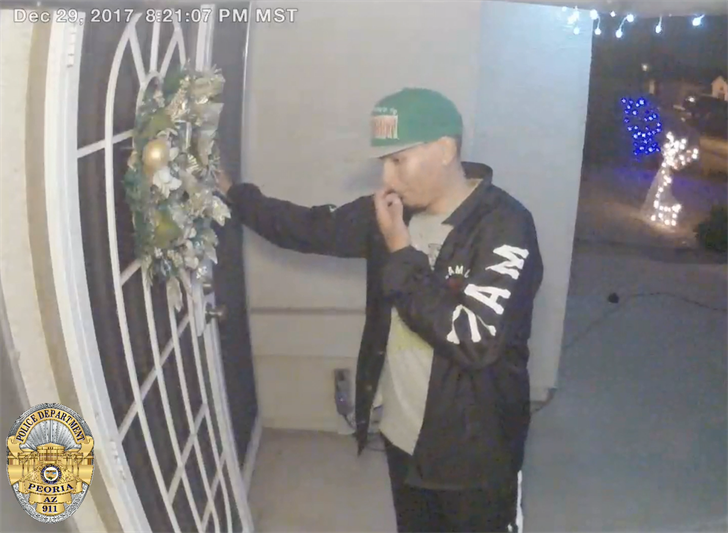 Footage shows a man ringing the doorbell and then knocking on the door. (Source: Peoria Police Department)