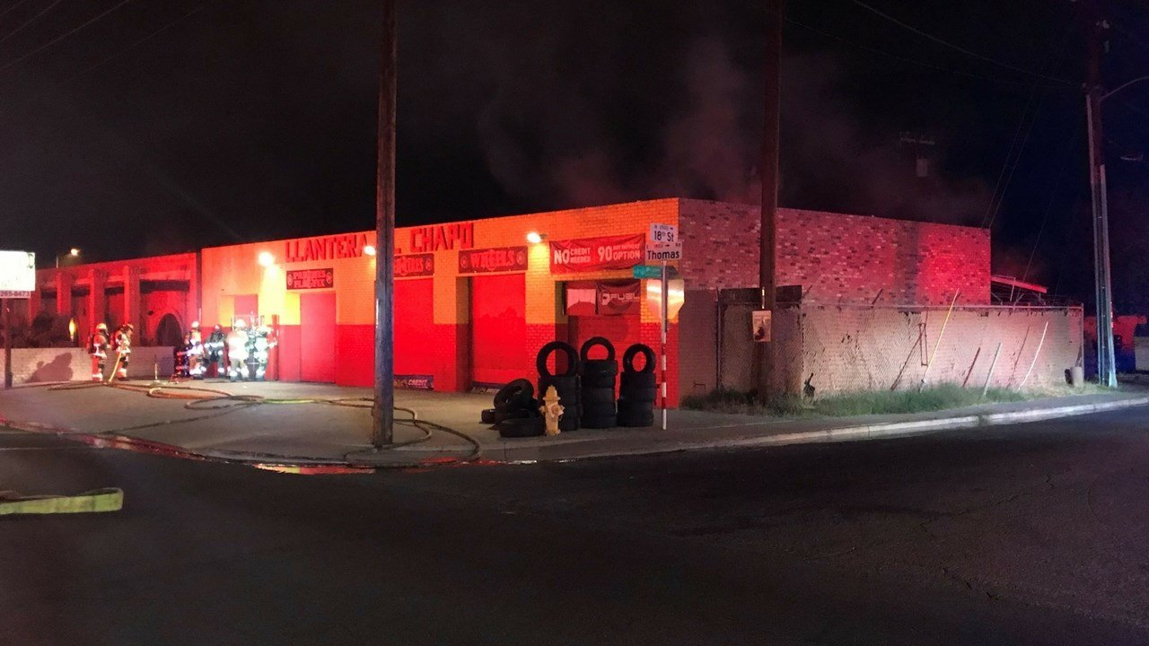 Tires caught fire behind this tire shop near 16th St. and Thomas Rd. Monday. 8 Jan. 2018 (Source: 3TV/CBS 5 News)