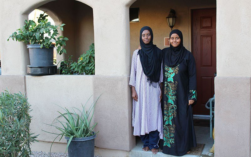 Refugee sisters Samah Mohamed, 17, and Huda Mohamed, 14, made their home in Mesa, Ariz. after fleeing from Kenya six years ago.