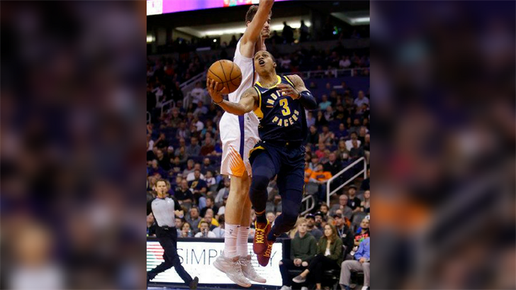 Indiana Pacers guard Joe Young (3) drives past Phoenix Suns forward Dragan Bender in the first half during an NBA basketball game, Sunday, Jan. 14, 2018, in Phoenix. (Source: AP Photo/Rick Scuteri)