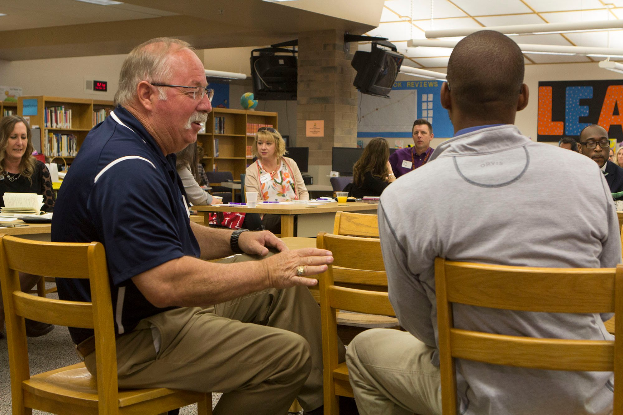 Youngker High School Principal Rob Roberson, left, has been an educator for 41 years, including 20 years as a school principal. He said he doesn't stress much anymore. (Photo by Paola Garcia/Cronkite News)