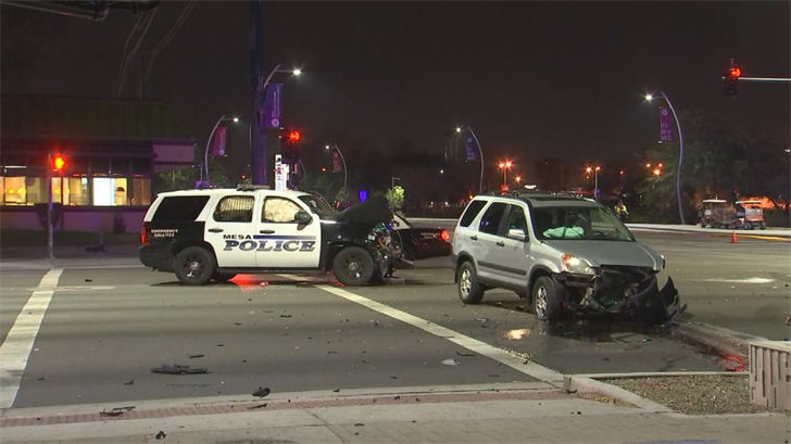 A Mesa police officer was hospitalized after a crash early Tuesday morning, police said. (Source: 3TV/CBS 5)