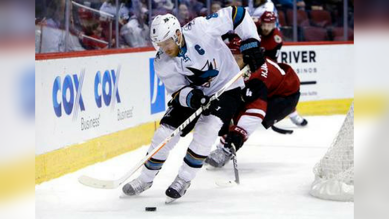 San Jose Sharks center Joe Pavelski (8) shields Arizona Coyotes defenseman Niklas Hjalmarsson from the puck in the first period during an NHL hockey game, Tuesday, Jan. 16, 2018, in Glendale, Ariz. (Source: AP Photo/Rick Scuteri)