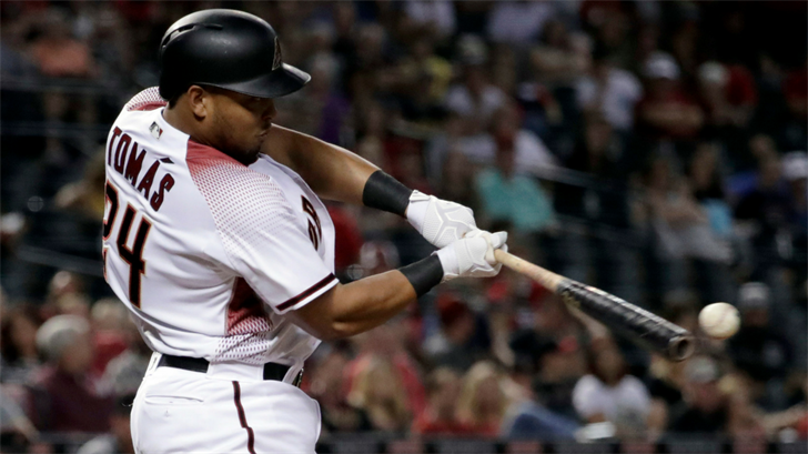 Arizona Diamondbacks' Yasmany Tomas connects for an RBI double against the San Diego Padres during the fourth inning of a baseball game, Monday, April 24, 2017, in Phoenix. (Source: AP Photo/Matt York)