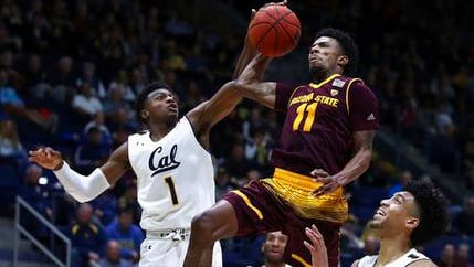 Arizona State's Shannon Evans II (11) shoots between California's Darius McNeill, left, and Justice Sueing during the second half of an NCAA college basketball game Saturday, Jan. 20, 2018, in Berkeley, Calif. (Source: AP Photo/Ben Margot)