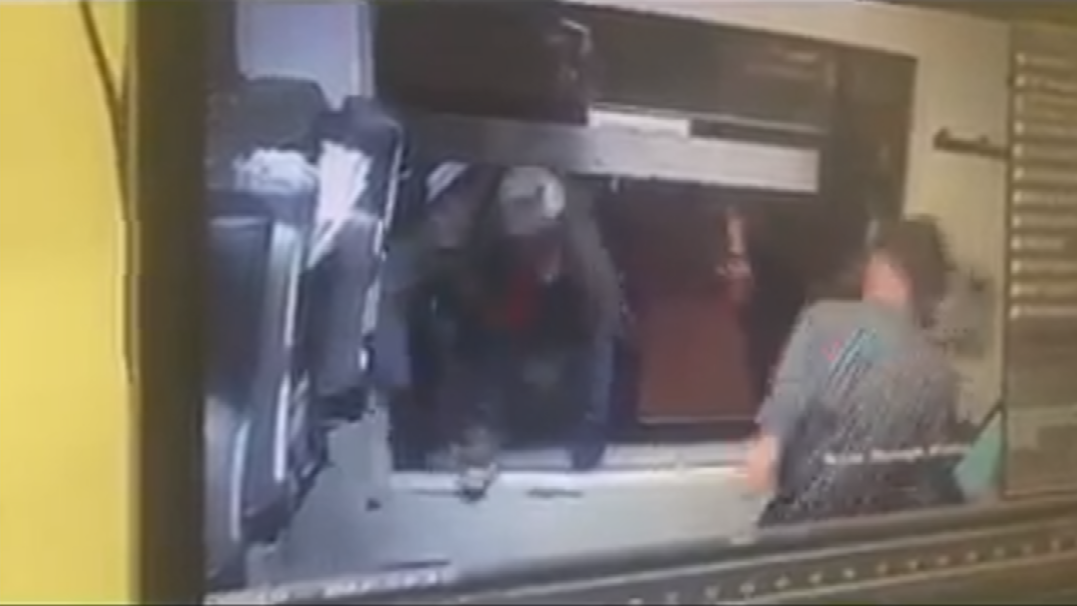 When the worker stepped to the side, a man crawled across the driver and through the drive-thru window. (Source: Cottonwood Police Department)