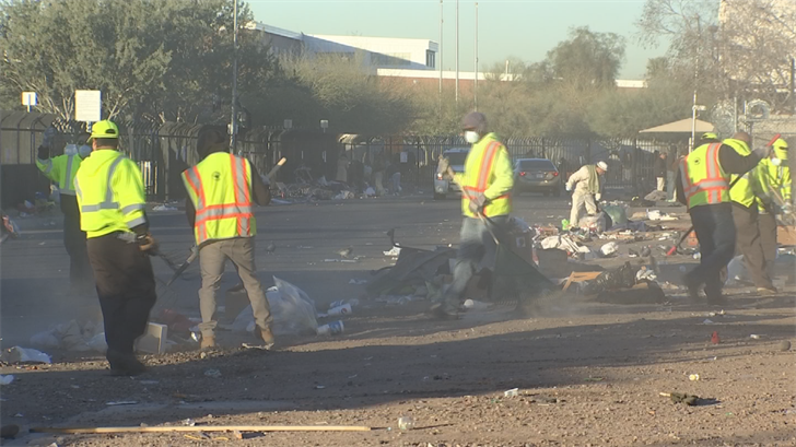Each Wednesday, around 8 a.m., the same squad of Phoenix police, street workers, and County inmates strive to clear and clean the block where the homeless camp is. (Source: 3TV/CBS 5)
