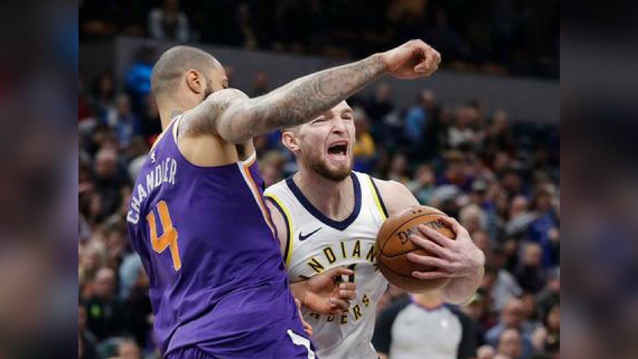 Indiana Pacers' Domantas Sabonis goes to the basket against Phoenix Suns' Tyson Chandler during the first half of an NBA basketball game Wednesday, Jan. 24, 2018, in Indianapolis. (Source: AP Photo/Darron Cummings)