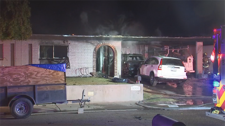 A family of four escaped safely from an early morning Phoenix house fire, according to fire officials. (Source: 3TV/CBS 5)