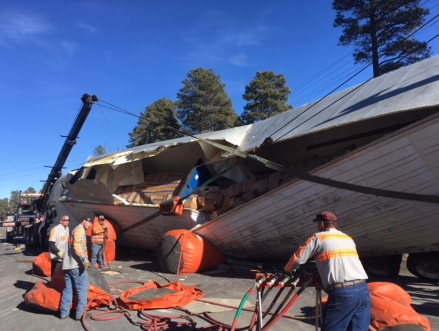 Crews work to clear a semi truck rollover accident from I-40 near Flagstaff. 27 Jan 2018 (Source: Arizona Dept. of Public Safety)
