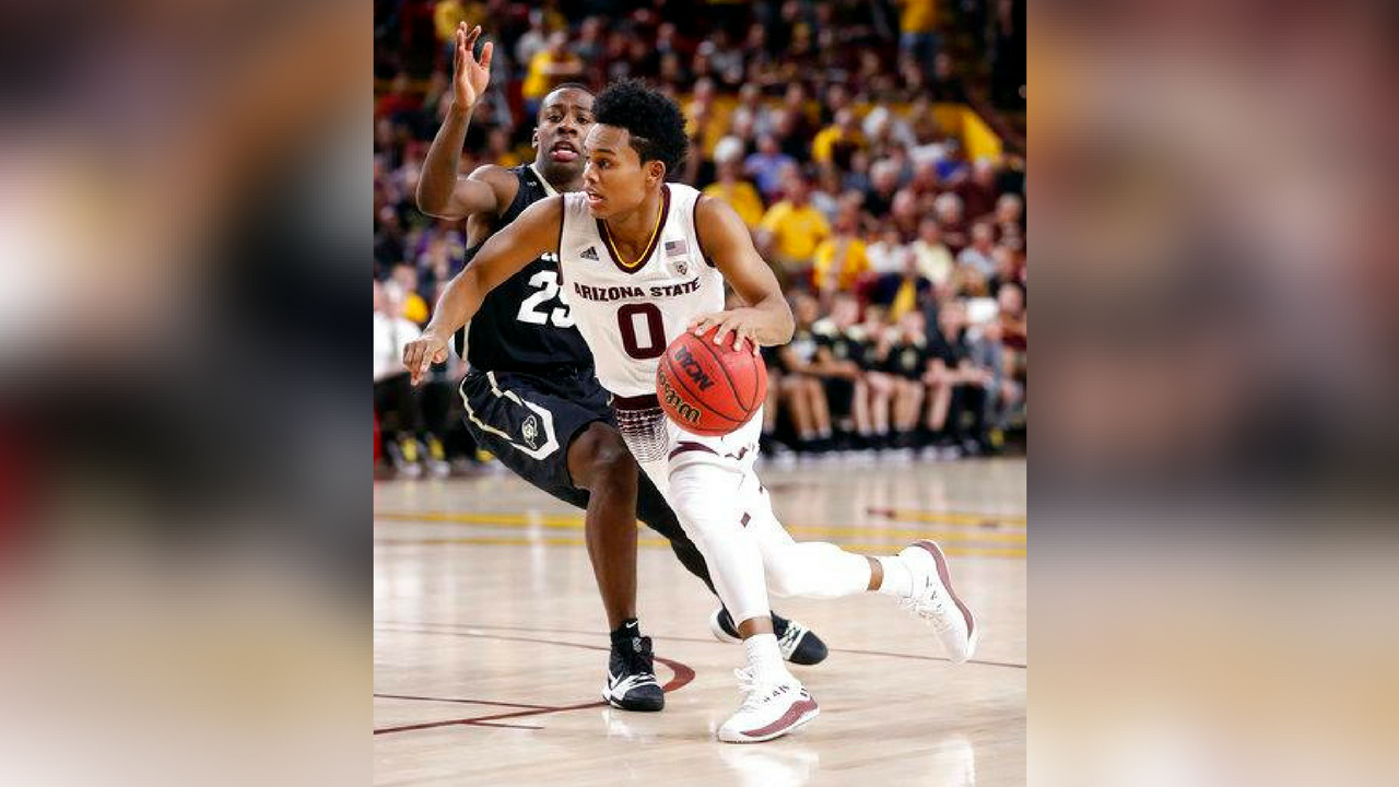 Arizona State guard Tra Holder (0) drives past Colorado guard McKinley Wright IV during the second half of an NCAA college basketball game, Saturday, Jan. 27, 2018, in Tempe, Ariz.(Source: AP Photo/Matt York)