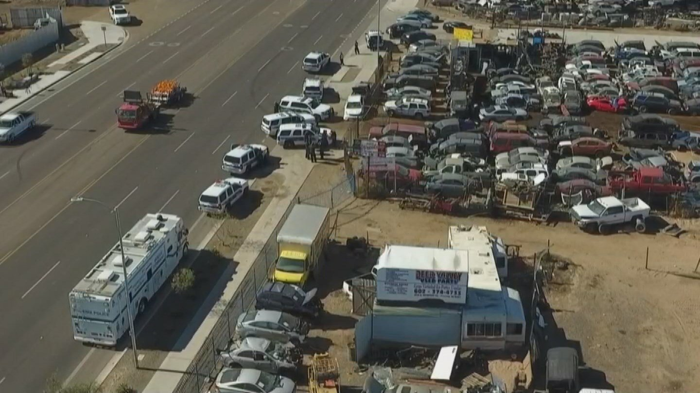 Footage from our drone showed there were at least eight police vehicles at a junkyard. (Source: 3TV/CBS 5)