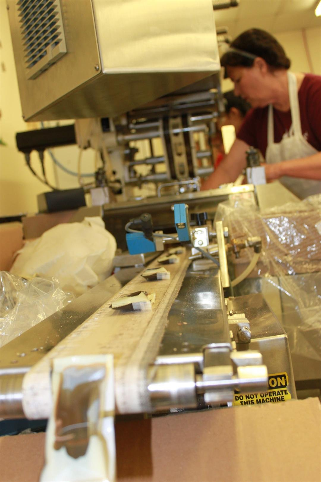 Dark chocolate boot-shaped chocolates coming down the conveyor belt at Cerreta Candy Company. (Source: City of Glendale)