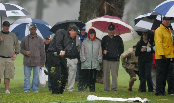 If there is a chance rain, officials will set up the hole location in higher areas of the green. (Source: The Associated Press)