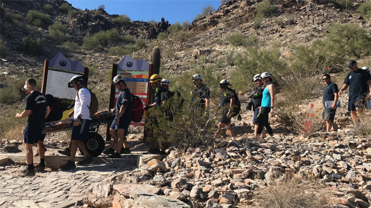 Crews using a 'big-wheel' to bring down a female hiker with an ankle injury on Piestewa Peak on Thursday, Feb. 1. (Source: Phoenix Fire Department)