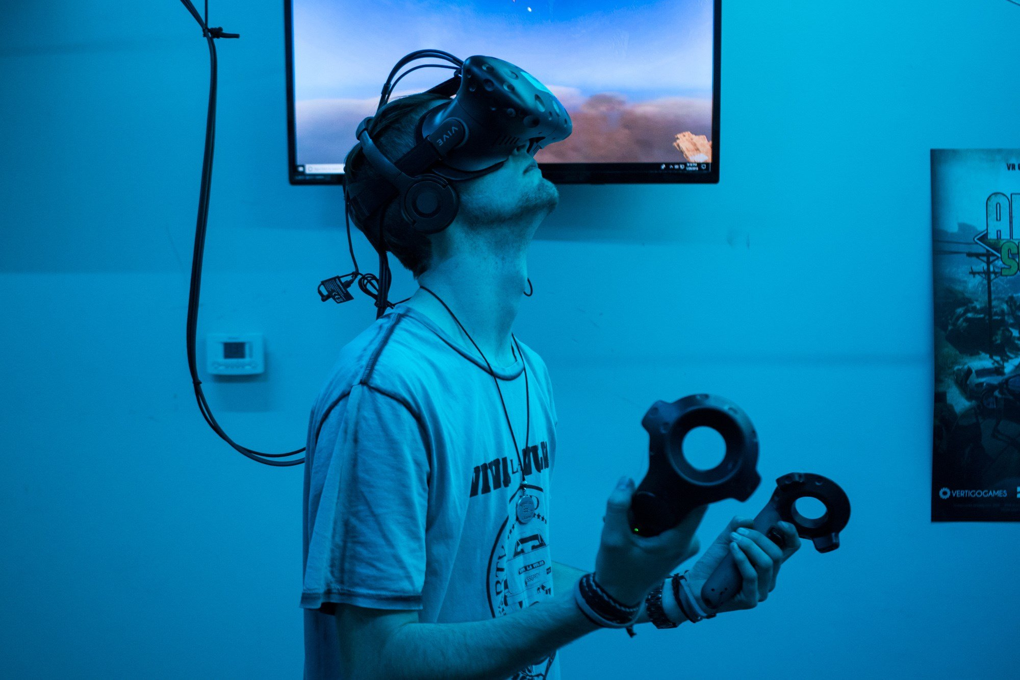 "Jack Fortin, who played ""Skyfront"" at a VR arcade, had planned to play for only 10 minutes but liked it so much that he came back later that night for another hour. (Source: Daria Kadovik/Cronkite News)"