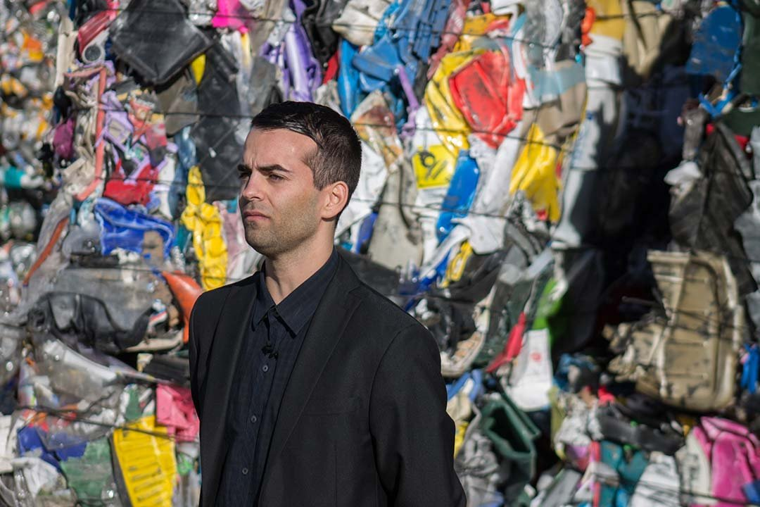 Lucas Mariacher, the Zero Waste coordinator for the city, looks out over bales of plastic at the 27th Avenue Transfer Station in Phoenix. (Source: Miles Metke/Cronkite News)