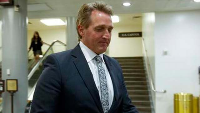 Sen. Jeff Flake, R-Ariz., walks to his office, Thursday, Feb. 8, 2018, at Capitol Hill in Washington. (Source: AP Photo/Jose Luis Magana)