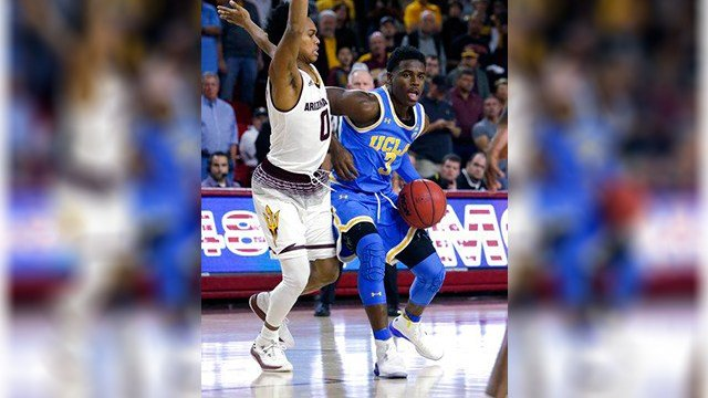 UCLA guard Aaron Holiday (3) drives on Arizona State guard Tra Holder in the first half during an NCAA college basketball game, Saturday, Feb. 10, 2018, in Tempe, Ariz. (Source: AP Photo/Rick Scuteri)