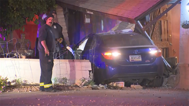 The car crashed into the home near 39th and Dunlap avenues. (Source: 3TV/CBS 5)