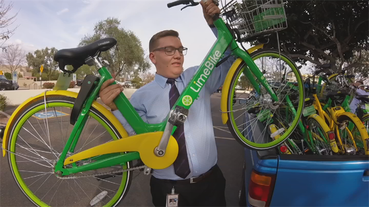 An intern with Councilman Sal DiCiccio is picking up rideshare bikes and sending them back to Scottsdale. (Source: 3TV/CBS 5)