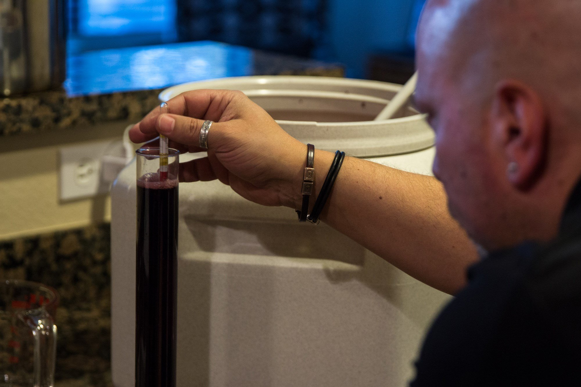 The wine must be carefully weighed and measured, which allows Louis Marconi of Chandler to detect small changes in sugar and alcohol content after fermentation. (Source: Jenna Miller/Cronkite News)