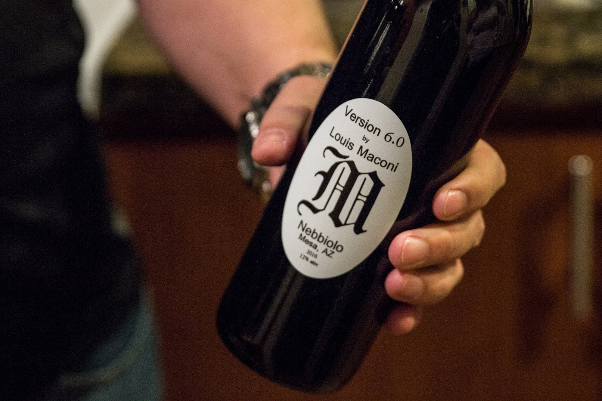 Louis Maconi has personal labels for his homemade wine. He believes his homemade product is better than some commercial wines. (Source: Jenna Miller/Cronkite News)