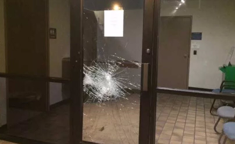 Suspect hurled rocks or bricks at police precinct on Dec. 26, 2015 (Source: 3TV/CBS 5)
