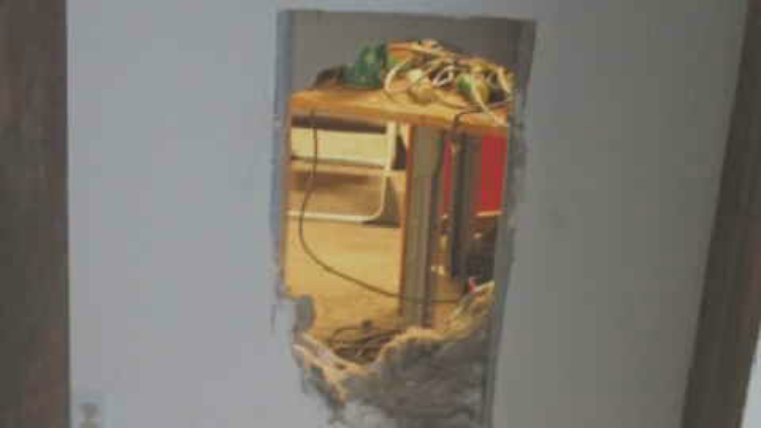 The crooks kicked through a piece of the wall. (Source: 3TV/CBS 5)