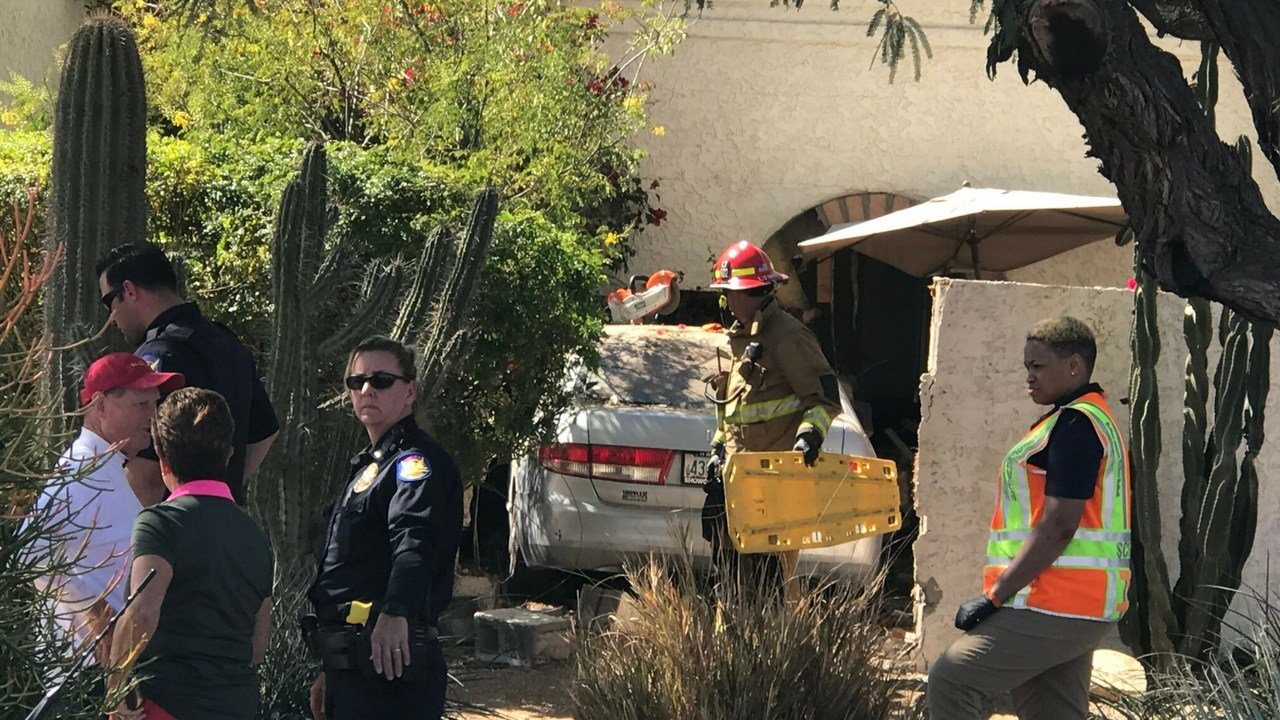 A car crashed into a Phoenix home Saturday afternoon. (Source: 3TV/CBS 5 News)