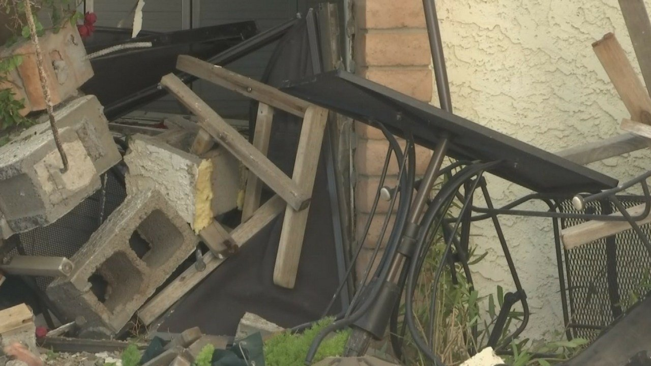 The car crashed through a patio wall and into the bedroom of the home. (Source: 3TV/CBS 5 News)