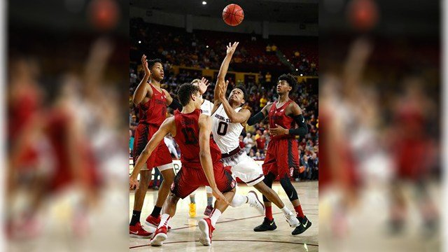 Arizona State guard Tra Holder (0) is fouled by Stanford forward Oscar da Silva (13) during the second half of an NCAA college basketball game Saturday, March 3, 2018, in Tempe, Ariz. (Source: AP Photo/Matt York)