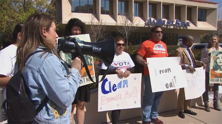 Demonstrators gathered outside the offices of Sen. Jeff Flake and Rep. Kyrsten Sinema, calling on them to push for a broader DREAM Act. (Source: 3TV/CBS 5)