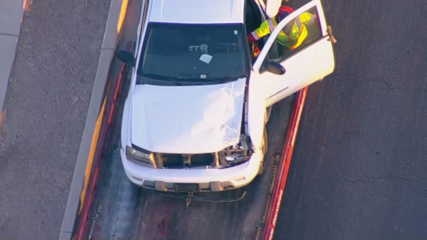 An SUV that was damaged in a collision with a zebra is loaded onto a flatbed truck. (Source: 3TV/CBS 5)